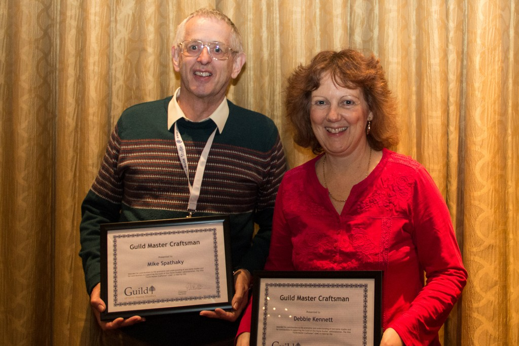 Mike Spathaky and Debbie Kennett with their certificates for appointment as Master Craftsmen of the Guild