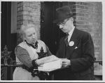 Woman filling in her 1939 Registration